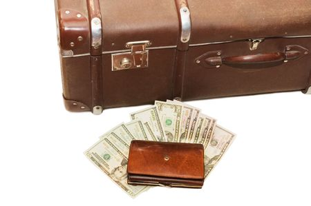lays: Money lays on an old suitcase