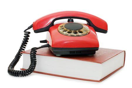 Czerwony telefonu w książce samodzielnie  Zdjęcie Seryjne