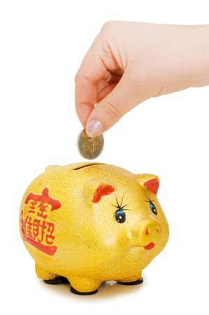 Piggy bank and hand with coin isolated Stock Photo - 6817959