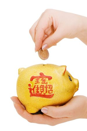 Piggy bank and hand with coin isolated Stock Photo - 6817961