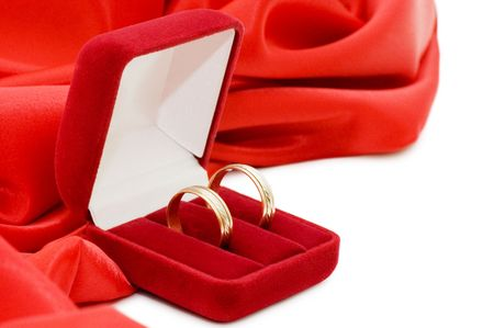 Red box with two gold wedding rings photo