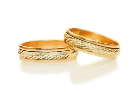 Two golden wedding rings. Isolated on white photo