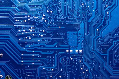 integrated circuits: Close up of computer circuit board in blue