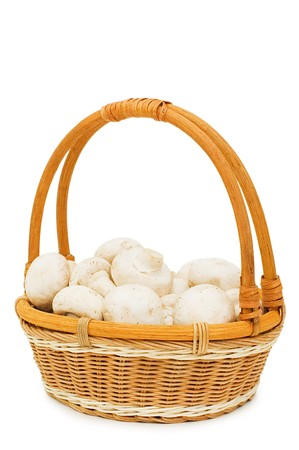 Wattled basket with field mushrooms isolated  photo