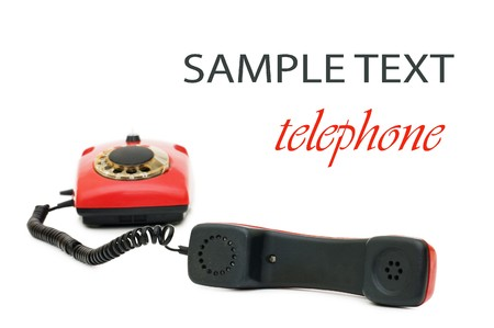 Red old telephone isolated on white  photo