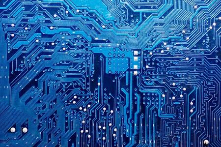 ferragens: Feche acima da placa de circuito do computador no azul