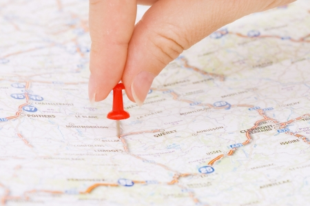 Red pushpin marking a location photo
