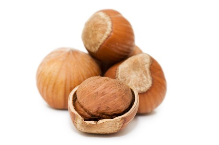 nut shell: Heap of hazelnuts on white background  Stock Photo