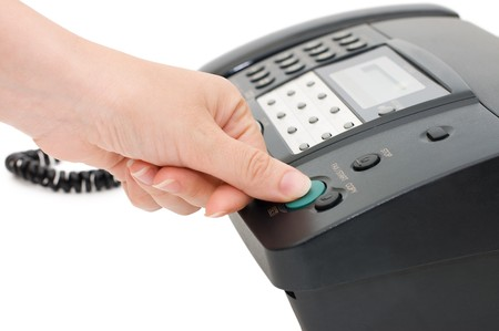 The hand presses the fax button photo
