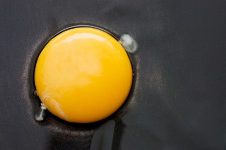 The broken egg on black background photo