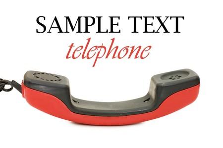 Retro telephone receiver isolated on white background  photo