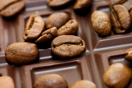 Background from coffee beans and chocolate Stock Photo - 7314495