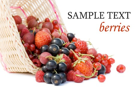 Ripe berries in a basket isolated on white background  photo
