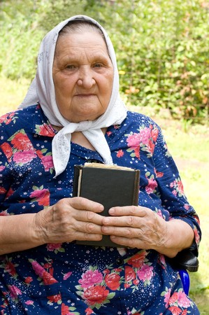 The old woman with the bible Stock Photo - 7496890