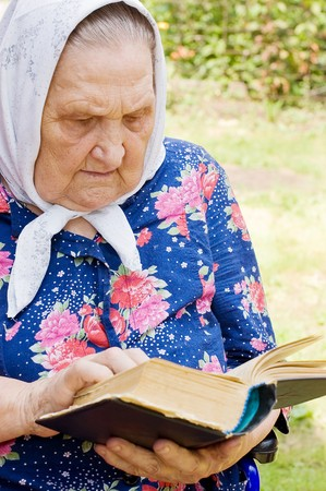 The old woman with the bible Stock Photo - 7561663