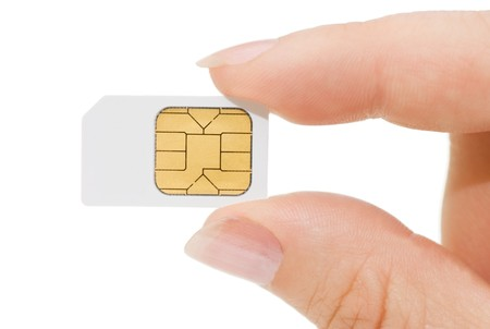 sim: Sim card In a hand isolated on white background