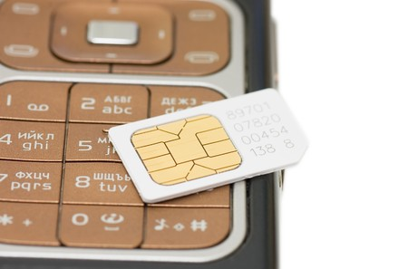 cellphone and sim card  isolated on white background  photo