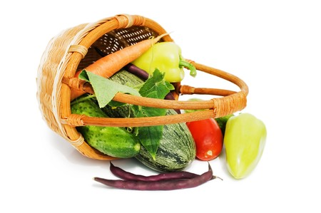 wattled: Wattled basket with vegetables isolated on white  Stock Photo