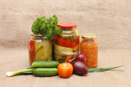 Fresh and tinned vegetables on a sacking photo