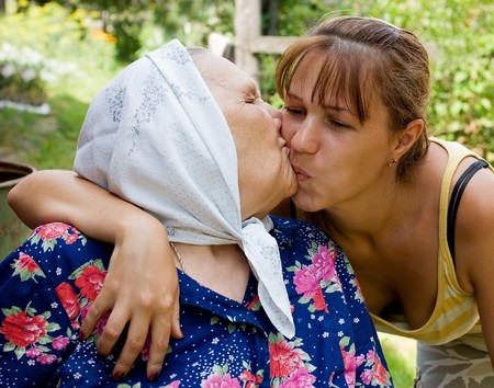 embraced: Grandmother and granddaughter embraced and happy