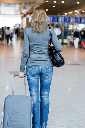 The girl with luggage at the airport photo