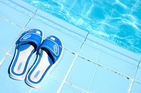 Pretty flip flops by the swimming pool photo