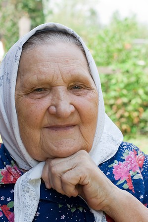 Portrait of the old woman in a scarf Stock Photo - 7907381