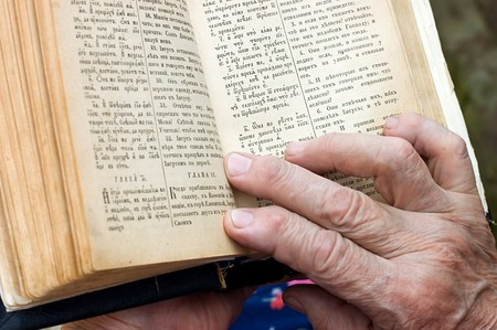 learning pray: The old woman reads the bible