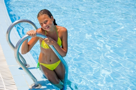 The young girl at pool Stock Photo - 7970978