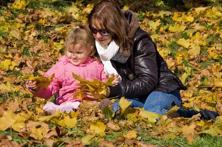 Mum with a daughter in autumn park photo