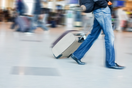 luggage airport: Man rushing to catch his flight in airport