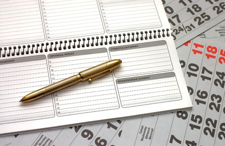Sheets of a calendar and a notebook Stock Photo - 8076383