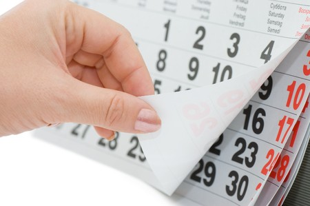 The hand overturns calendar sheet isolated on white background  Stock Photo - 8076333