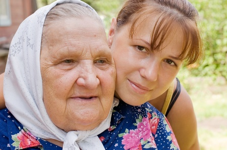 Grandmother and granddaughter embraced and happy  photo