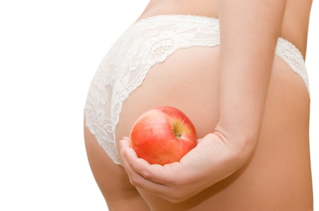 Female buttocks and apple in a hand Stock Photo - 8241736