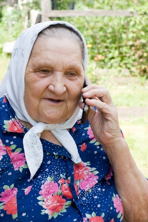 grandmother talking with a phone Stock Photo - 8384034