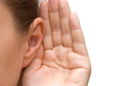 ears: Girl listening with her hand on an ear Stock Photo