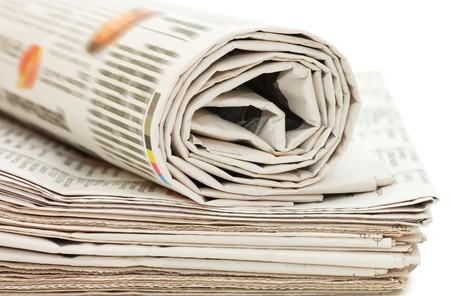 Roll of newspapers, isolated on white background photo