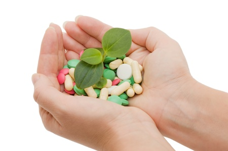nutritional supplement: Hand with a pill on white background
