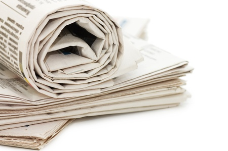 advertisements: oll of newspapers, isolated on white background  Stock Photo