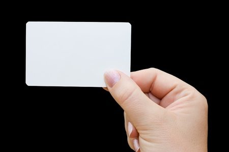 Paper card in woman hand isolated on black background Stock Photo - 8451938