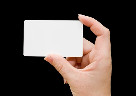 Papier-Karte in der Hand der Frau isolated on black background