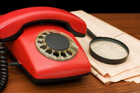Red phone on a wooden table photo