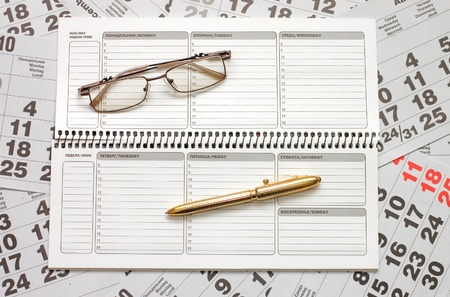 Sheets of a calendar and a notebook Stock Photo - 8507862