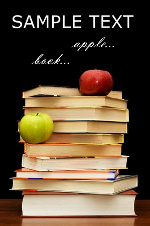 library book: Stack of books and apple On a black background