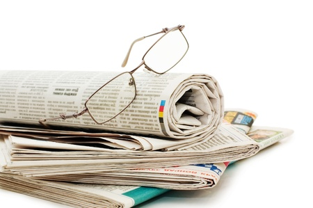 broadsheet: oll of newspapers, isolated on white background  Stock Photo