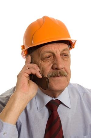speaks: Engineer speaks by phone isolated on white