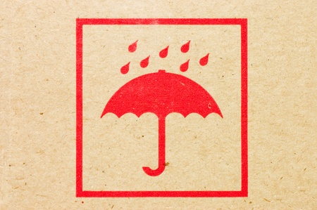 Sign an umbrella on a box photo
