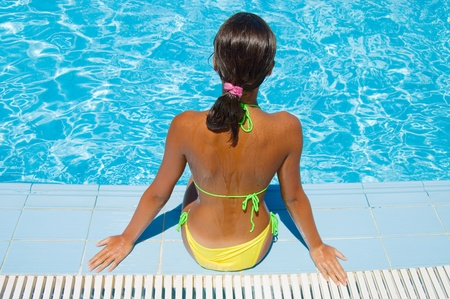 The young girl at pool photo