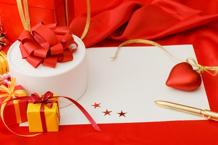 Box with a gift on a red fabric photo